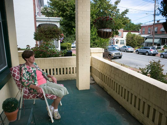 Phyllis Hines sits on the porch of her home on North Lincoln Street in September 2016.