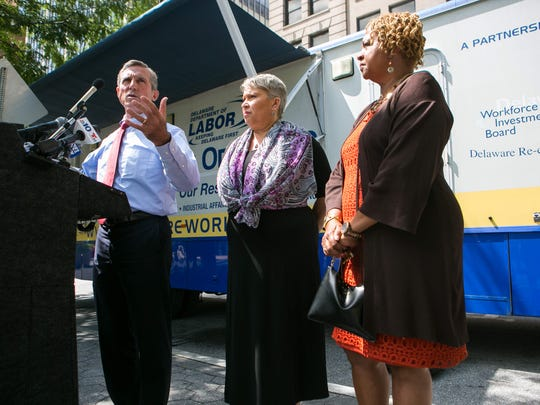 Gov. John Carney, Delaware Secretary of Labor Patrice Gilliam-Johnson and Wilmington City Council President Hanifa Shabazz join at Rodney Square as they kick off the job search initiative in Wilmington. The bus, called Mobile One-Stop, is equipped with computers and other resource tools.