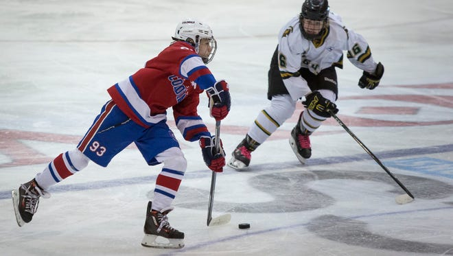 New Jersey Colonials' Damien Carfagna passes the puck during a Silver Stick Bantam AAA hockey game Thursday, Jan. 12, 2017 at McMorran Arena.