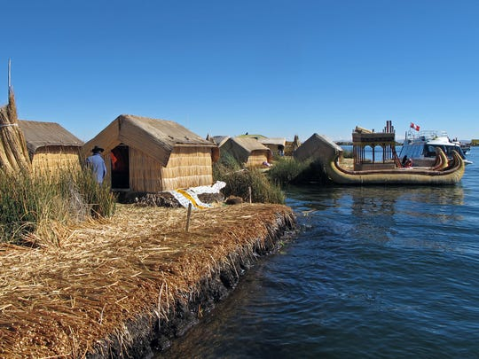 The pre-Inca Uros people on Lake Titicaca live on floating islands of reeds near Puno, Peru.