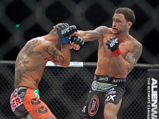Frankie Edgar lands a punch on Cub Swanson during their UFC Fight Night main event in November.