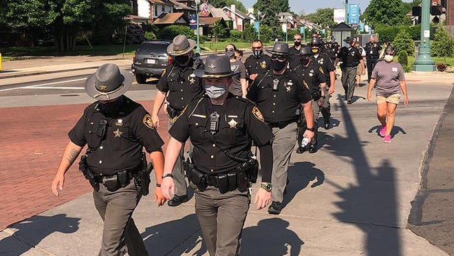 "About 20-25 Stark County Sheriff's deputies and Canton police officers joined protesters marching from Stadium Park to downtown Canton on June 6, 2020. The ""Save Black Lives"" march was meant to demonstrate against police brutality and racism, but it was not against law enforcement as a whole."