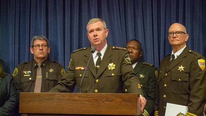 Kankakee County Sheriff Mike Downey - one of the sheriffs involved in a lawsuit against the state regarding transfers from county jails to state prisons - is pictured in a file photo at the Illinois Statehouse in February.