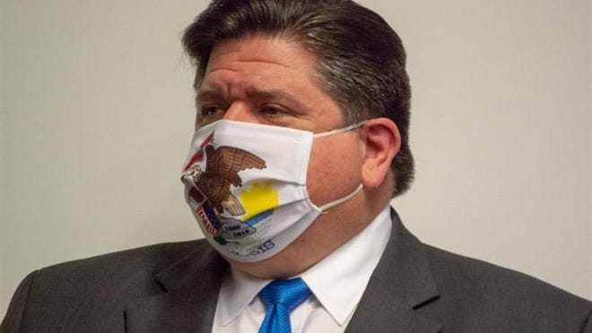 """llinois Gov. JB Pritzker listens as IEMA Director Alicia Tate-Nadeau introduces him to unveil a new mask awareness campaign called """"It Only Works If You Wear It"""" during a press conference at the IEMA State Emergency Operations Center, Monday, August 3, 2020, in Springfield."""