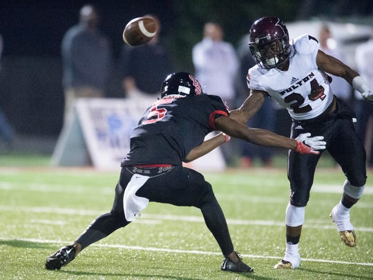 Central's Shermar Moore breaks up a pass intended by