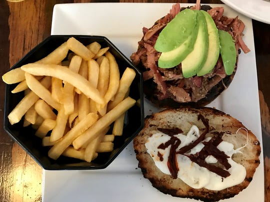 The Smoked Pork sandwich from Desert Moon Cafe, 310 Florence St., is made ith black bean spread, mozzarella, avocado, chipotle and sesame.