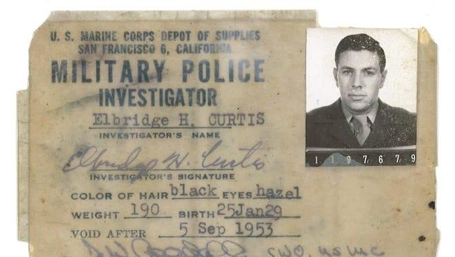 Elbridge's Military Police ID card.