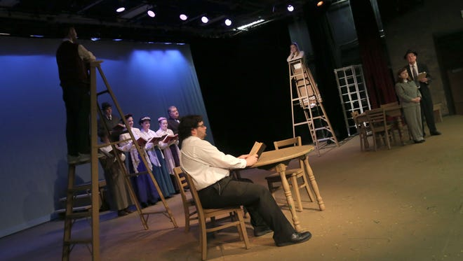 Members of the cast from the Ohio State Mansfield production of Our Town rehearse a scene from the play.