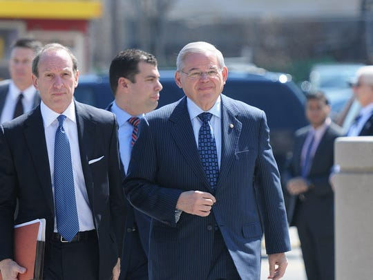 Sen. Bob Menendez, right, is accused of taking bribes