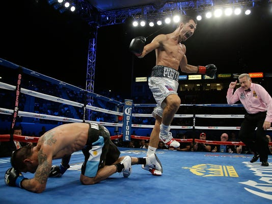 Viktor Postol stuns Lucas Matthysse with 10th round KO to claim WBC title