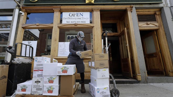 A food delivery arrives at restaurant providing takeout service during the coronavirus pandemic.