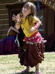 Arianna Cook, 4, dances at the 29th annual Tulare County Renaissance Fair at Plaza Park on Saturday, April 21, 2018.