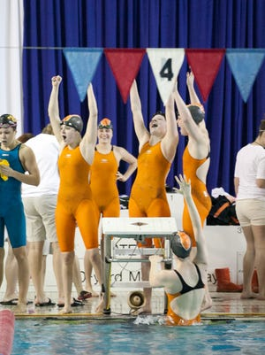 Ames celebrates a victory in the 200-yard medley relay last season. The Little Cyclones will try to win a fifth consecutive state girls' swimming title this weekend.