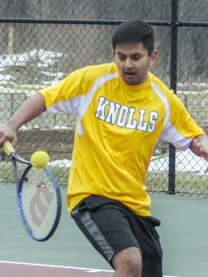 Morris Knolls senior Rushi Makadia prepares to hit a backhand during practice at Morris Knolls High School in Denville, March 27, 2018.