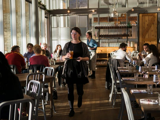 Floor manager Madeleine Holdford serves diners at The