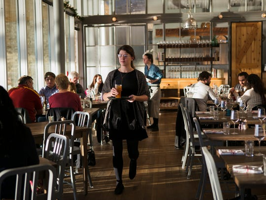 Floor manager Madeleine Holdford serves diners at The Kitchen, located at Shelby Farms Park, on Dec. 29, 2017.