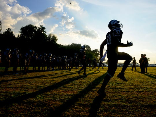 South Side players warm up on a practice field at the