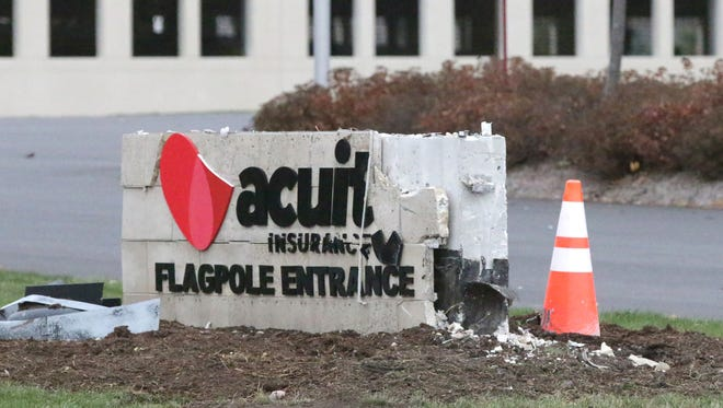 A damaged entrance sign at Acuity Insurance Headquarters as seen Saturday, a day after a traffic fatality in Sheboygan that left a 58-year-old Sheboygan Falls woman dead.