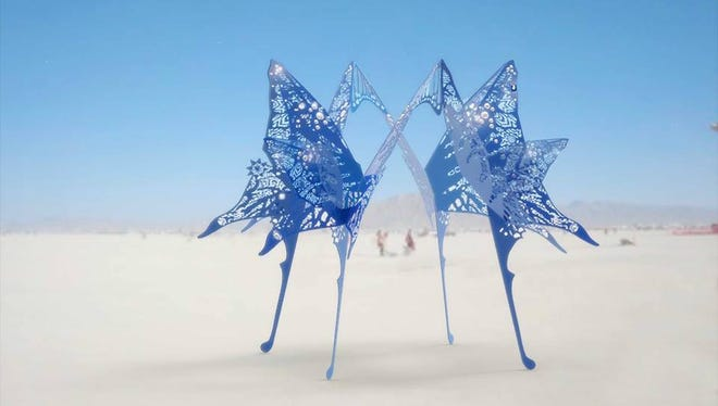 """""""Imago"""" is a group of 4 mirror-steel, blue butterflies elevated 15' over the Playa. The main material is mirror-polished stainless steel in a vibrant blue on both sides. Honorarium Grant recipient for Burning Man 2016."""