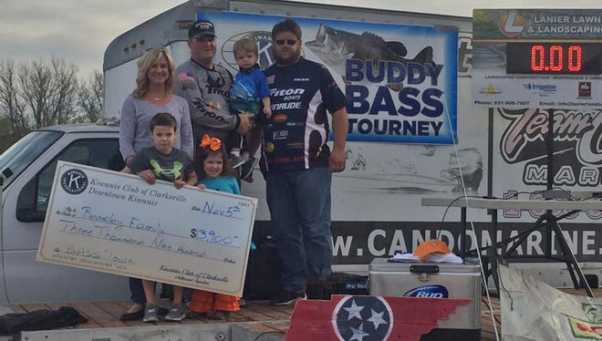The Beasley family with Chris Lanier and James McKee, who donated their winnings from the tournament.