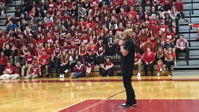 Mike Smith, motivational speaker, talks to Milford High School students.