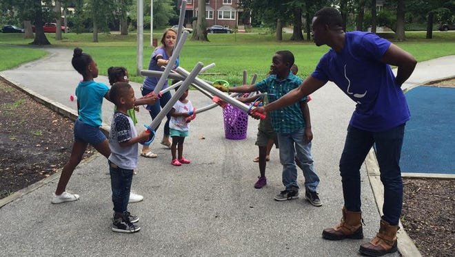 """Members of the Delaware Shakespeare company leading children through """"Shakespeare's Playground."""""""