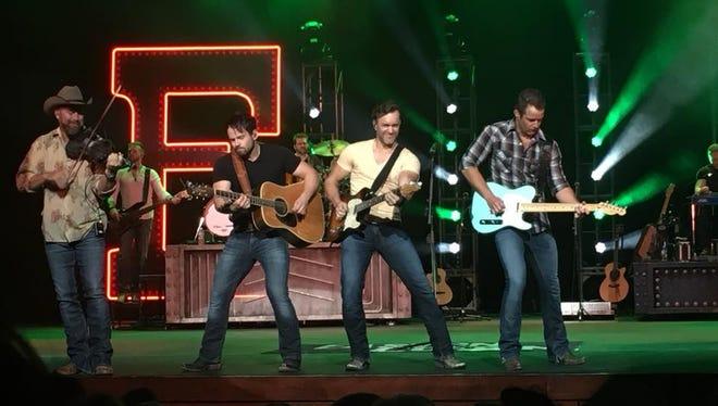 Easton Corbin (far right holding blue guitar) recently performaned at the Niswonger Performing Art Center in Van Wert.