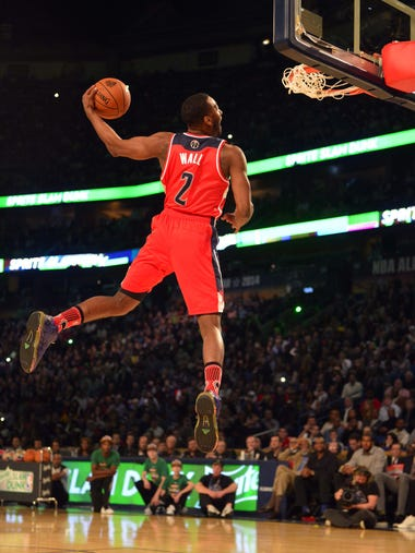 John Wall – First overall to the Washington Wizards, where he still plays - Feb 15, 2014;  Mandatory Credit: Bob Donnan-USA TODAY Sports
