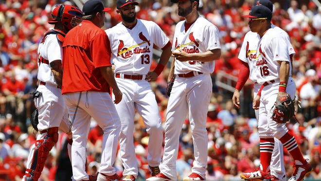 Cardinals pitching coach Derek Lilliquist, second from left, makes a visit to the mound to speak with starting pitcher Jaime Garcia during the third inning of a Sunday's game against the Arizona Diamondbacks in St. Louis. The Diamondbacks won the game 7-2.