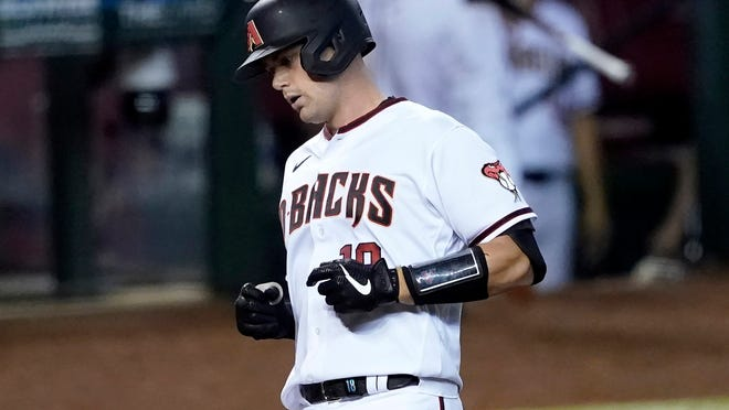 Arizona Diamondbacks' Carson Kelly crosses the plate after hitting a two run home run against the Los Angeles Dodgers during the sixth inning of a baseball game, Thursday, Sept. 10, 2020, in Phoenix. (AP Photo/Matt York)