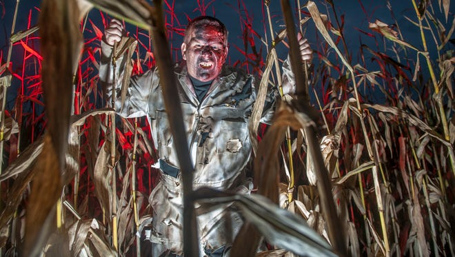 Glenn Huber of Somerdale portrays a biohazard burn victim as he works Creamy Acres Farms' Night of Terror in Mullica Hill.  10.24.14