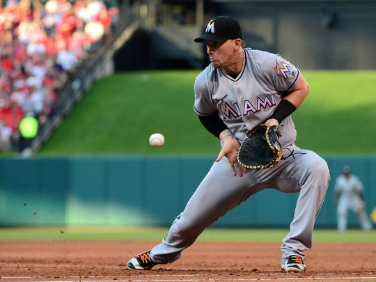 Jul 16, 2016; St. Louis, MO, USA; Miami Marlins first baseman Chris Johnson (12) fields a ground ball hit by St. Louis Cardinals second baseman Kolten Wong (not pictured) during the third inning at Busch Stadium. Mandatory Credit: Jeff Curry-USA TODAY Sports