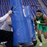 Mississippi State linebacker Benardrick Mckinney runs a drill at the NFL football scouting combine in Indianapolis, Sunday, Feb. 22, 2015. (AP Photo/David J. Phillip)