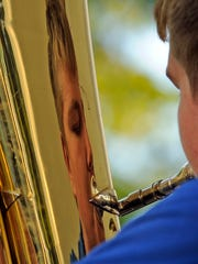 File - Max Alef performs on the tuba with the Manitowoc Marine Band July 17, 2014, at Washington Park in Manitowoc.