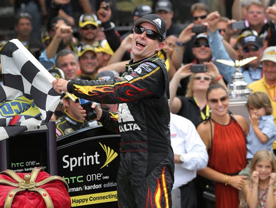 NASCAR driver Jeff Gordon celebrates his fifth Brickyard