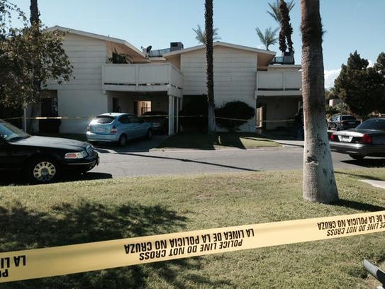 Police investigate an apartment complex after the fatal