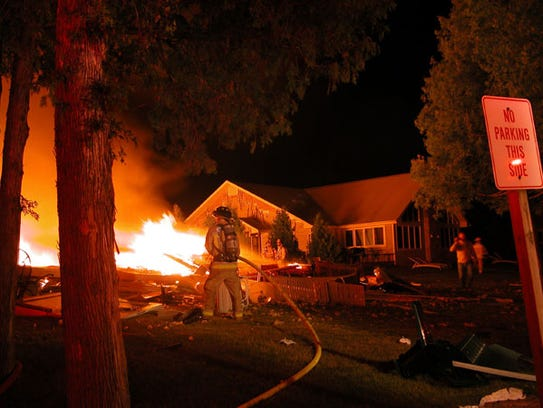 Firefighters battle to save a building at the Cedar