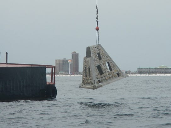 Escambia County workers deploy an artificial reef off