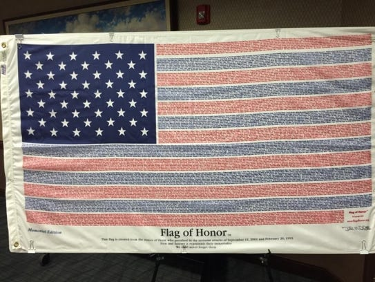 The Flag of Honor features the names of the victims