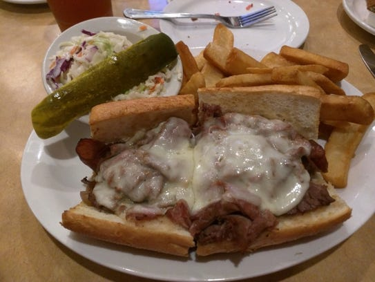 TooJay's beef brisket dip on a roll with plenty of
