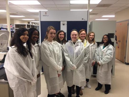 Students from Menomonee Falls High School wear lab