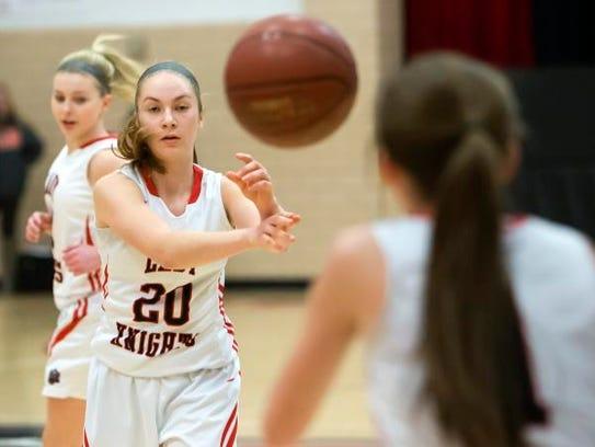 Lourdes Academy's Maggie Berenz throws a pass to Quinn