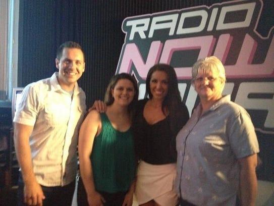 Radio DJ Kyle Smelser, with Hidden Cash Indy winner Rose Walker, his morning DJ partner Rachel Bogle, and Rose's mother Michele Walker.
