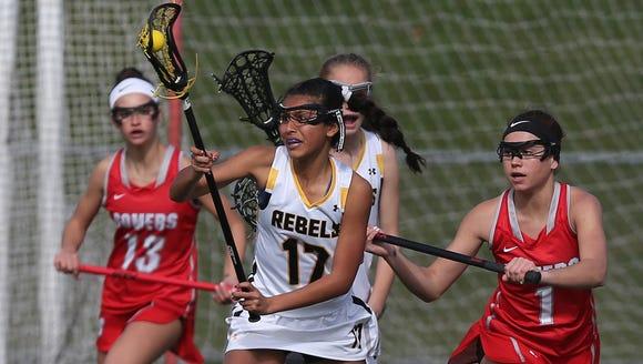 Lakeland/Panas' Raquel Nieves (17) moves the ball away