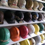 A display of protective helmets through the years at the Museum of the Coal Industry in Lynnville, Ind.