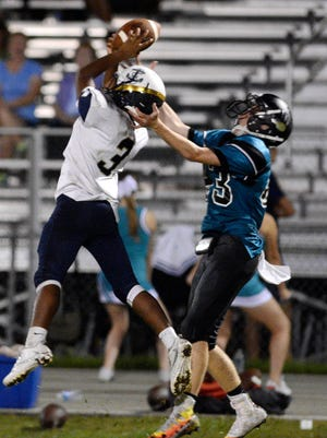 Eau Gallie's Cam Noel (3) picked off a pass intended for Austin Churchel of Bayside and ran it back for a TD during Friday's game.