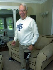 """Jerry Berkesch, a diehard Detroit Tigers fan, proudly shows off the Old English """"D"""" he has on his prosthetic leg."""