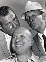 Bing Crosby and Phil Harris cavort with Jimmy Van Heusen.