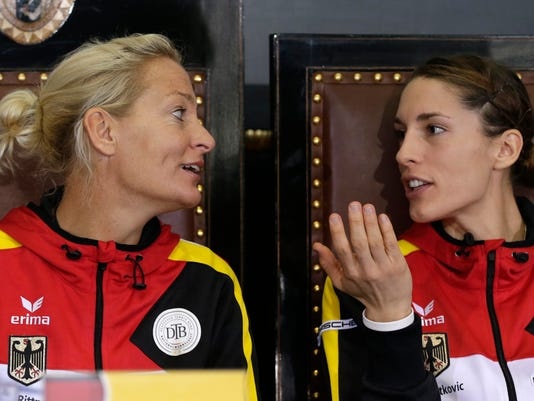 Germany's team captain Barbara Rittner, left, talks with Andrea Petkovic, right, during the  draw for the tennis Fed Cup Final between Czech Republic and Germany in Prague, Czech Republic, Friday, Nov. 7, 2014. (AP Photo/Petr David Josek)