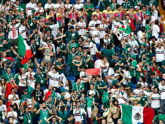 Mexico fans celebrate after their team's 2-1 win over